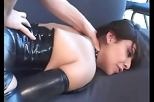 Latex wearing slut sucks big dick to make it cum
