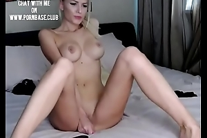 Naughty blondie with hot body rubs her pussy