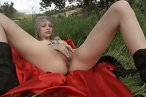 On the grass masturbating