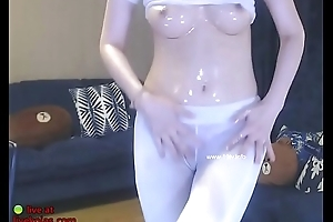 Horny Korean in leggings oils her body