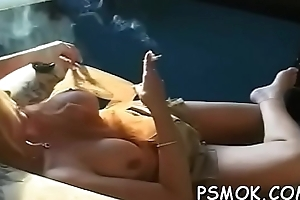 Slutty honey laying down and relishing a relaxing smoke