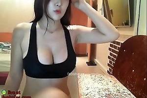 Busty Korean shows her huge upfront tits