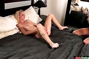 Sexy les with pierced nipples licks pussy