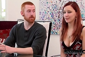 Redhead couple arrives and signs contract before swing fest