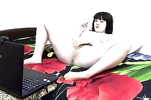 A brunette on a webcam in Skype communicates with a friend fetishist, she smokes and masturbates in nylon pantyhose.