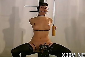 Woman stands with her bumpers tied up in sexy bondage scenes