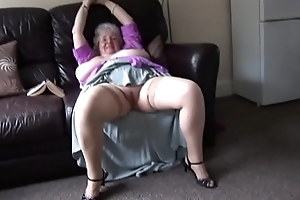 Mature granny with massive tits and hairy bush vandalization and teasing