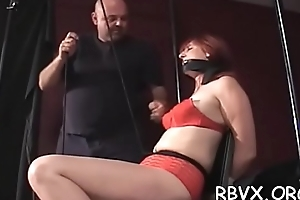 Breasty honey gets her tits strapped tight as she gets aroused