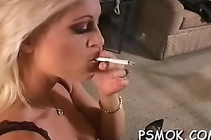 Jaw dropping masher teasing with a cigarette in her face cleft