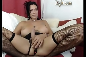 canadian shemale milf in stockings stroking her big cock