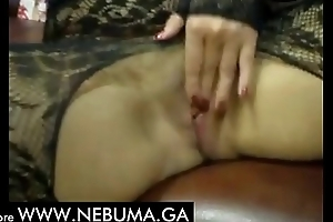 an elderly lady caresses herself and works her mouth
