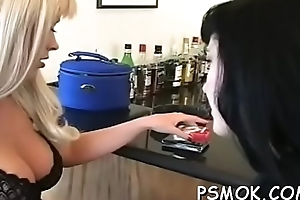 Busty babe playing with her titties whilst smoking a cigarette