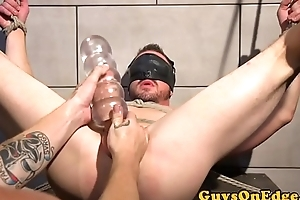 Bondage hunk gets his dick tugged with sextoy