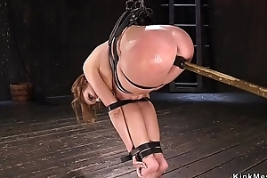 Busty oiled babe pussy toed in bondage
