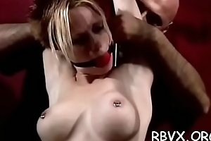 Bitch gets a ball gag in her face hole while being belted to bed