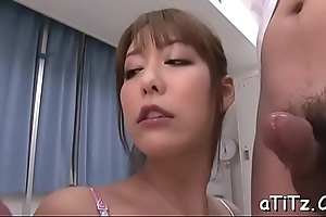 Asian babe with lovely pantoons gives magnetizing blowjob
